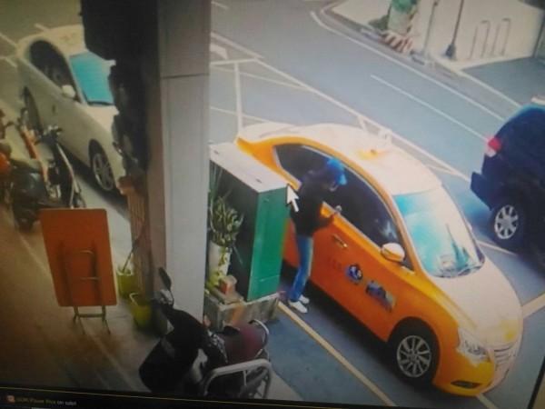 man gets into cab