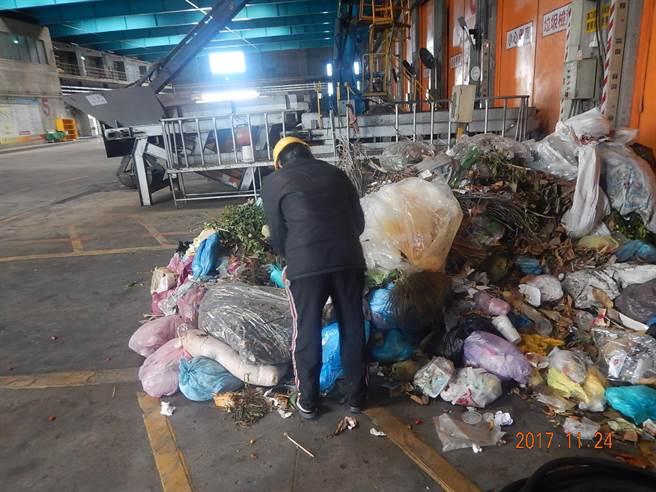 man rummaging through trash