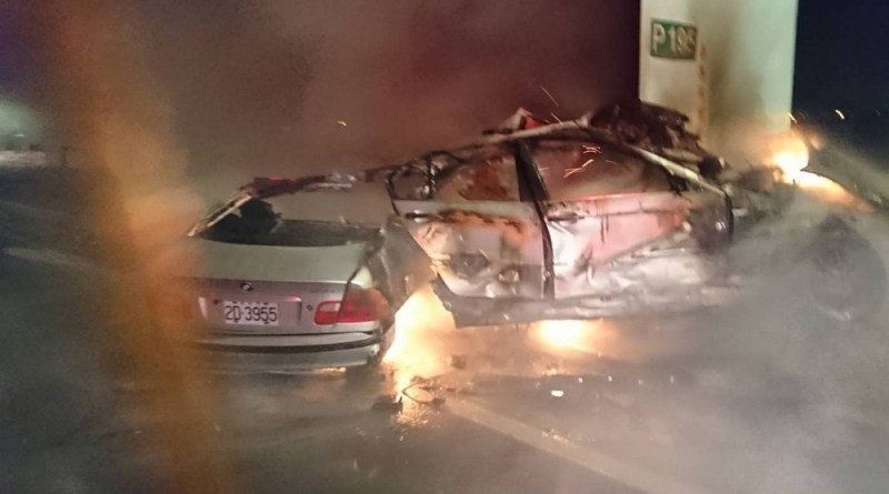 BMW sedan almost broken in half before going up in flames