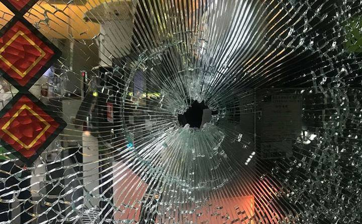 shattered glass and bullet hole