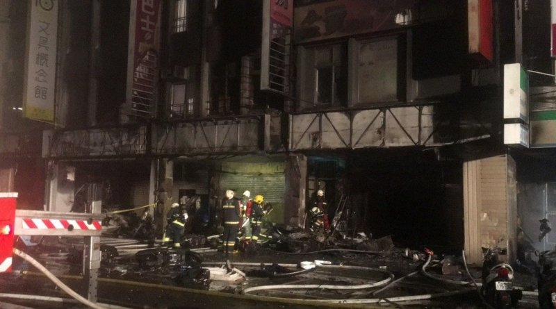 buildings damaged by fire after car crash