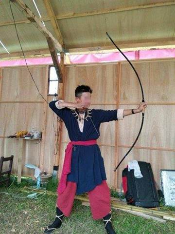 Murder suspect with longbow