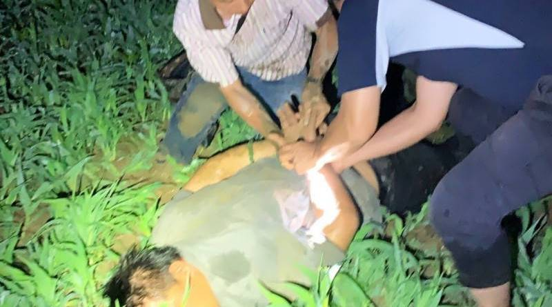 suspect arrested in muddy vegetable field