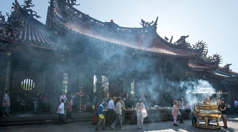 A smokey Longshan Temple before a ban on burning incense is put into place
