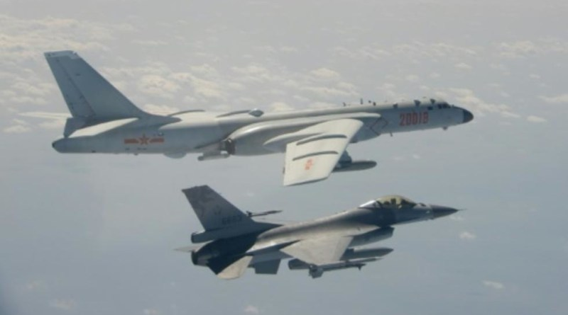 A Chinese PLA H-6 bomber is flanked by an F-16 of the ROC Air Force