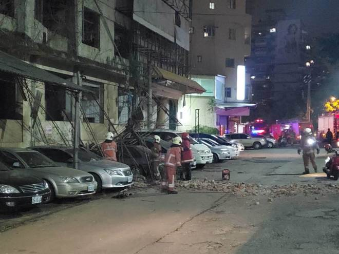 firefighters at the scene of minor earthquake damage in Hsinchu County, Taiwan, December 10, 2020.
