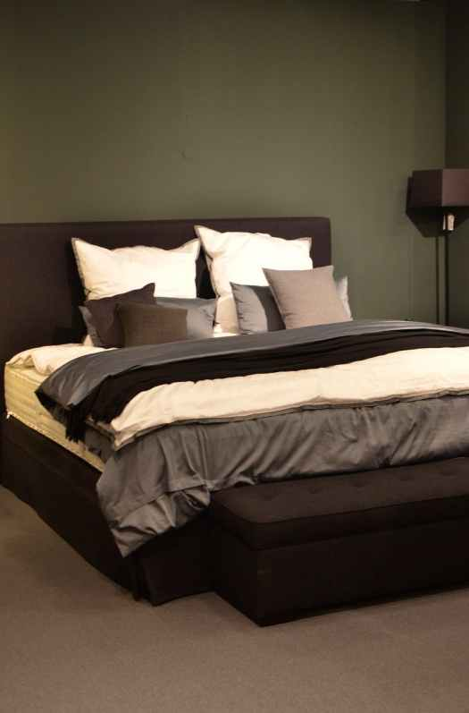 bed with cushions and cover at home