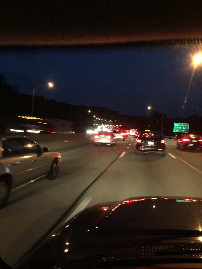 Interstate highway clogged with traffic at nightfall during an evening commute