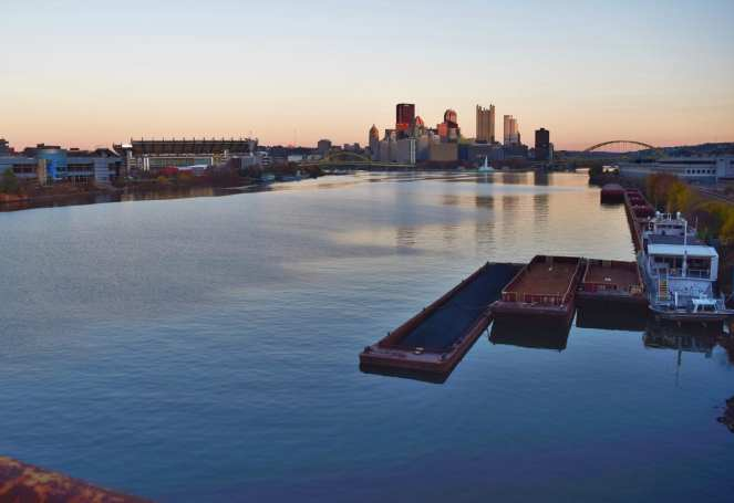 coal barges ohio river downtow pittsburgh west end bridge