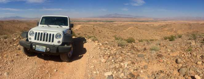 A white Jeep crosses the desert in Logandale Trails OHV park north of Las Vegas