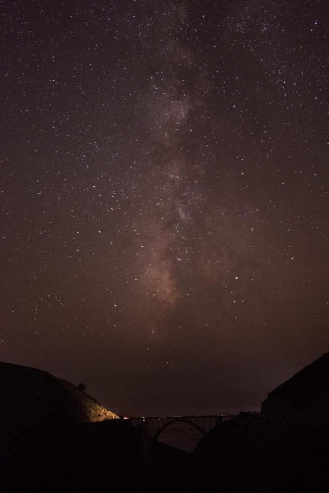 Milky Way galaxy over Big Sur California. Bixby Bridge. Constellations. Stars. Starry night. Dark sky. Dark skies. long exposure.