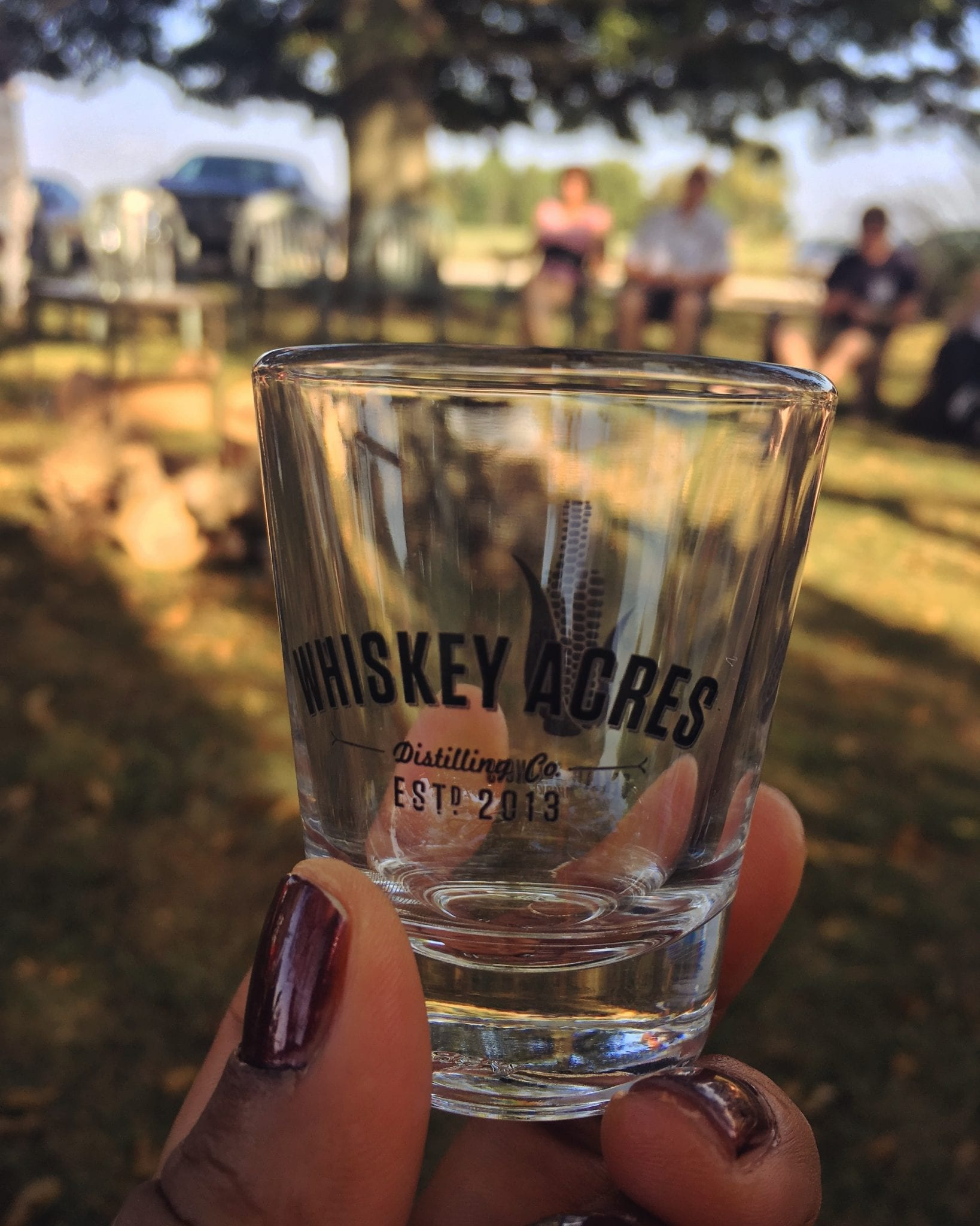 an empty whiskey acres shot glass at the distillery in Dekalb Indiana