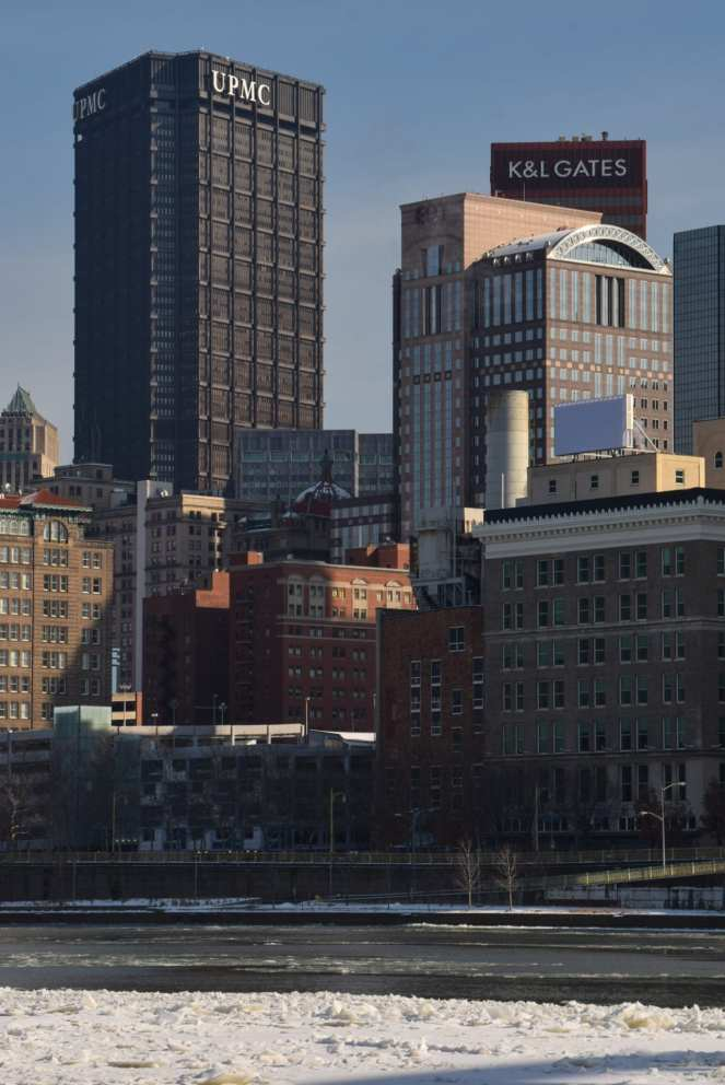 The UPMC (former US Steel) Building towers over the icy Allegheny River on a sunny winter afternoon in Pittsburgh