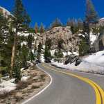 A back road winds up a snowy mountain