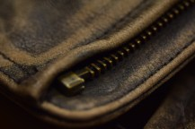 macro photo of leather jacket zipper