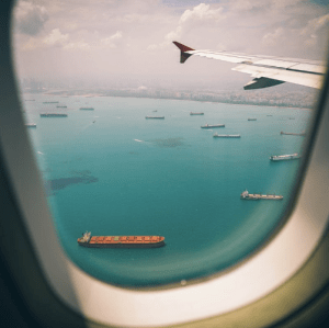 Aeroplane window looking out onto ocean