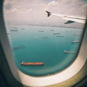 Aeroplane window looking out onto ocean