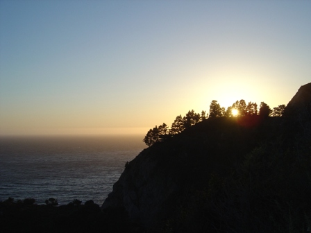 sunset behind a hill in the big sur mountains, pacific coast highway