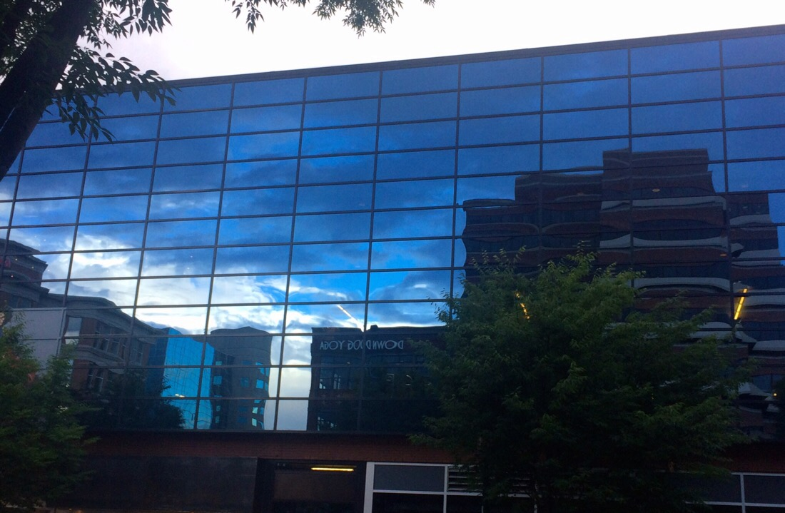 clouds reflected in the glass windows in bethesda, maryland