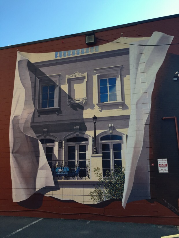 art work on the side of a building on cordell ave in bethesda, maryland