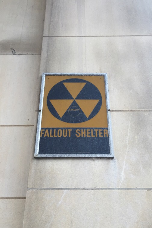 fallout shelter sign on the wall of a government building in washington dc
