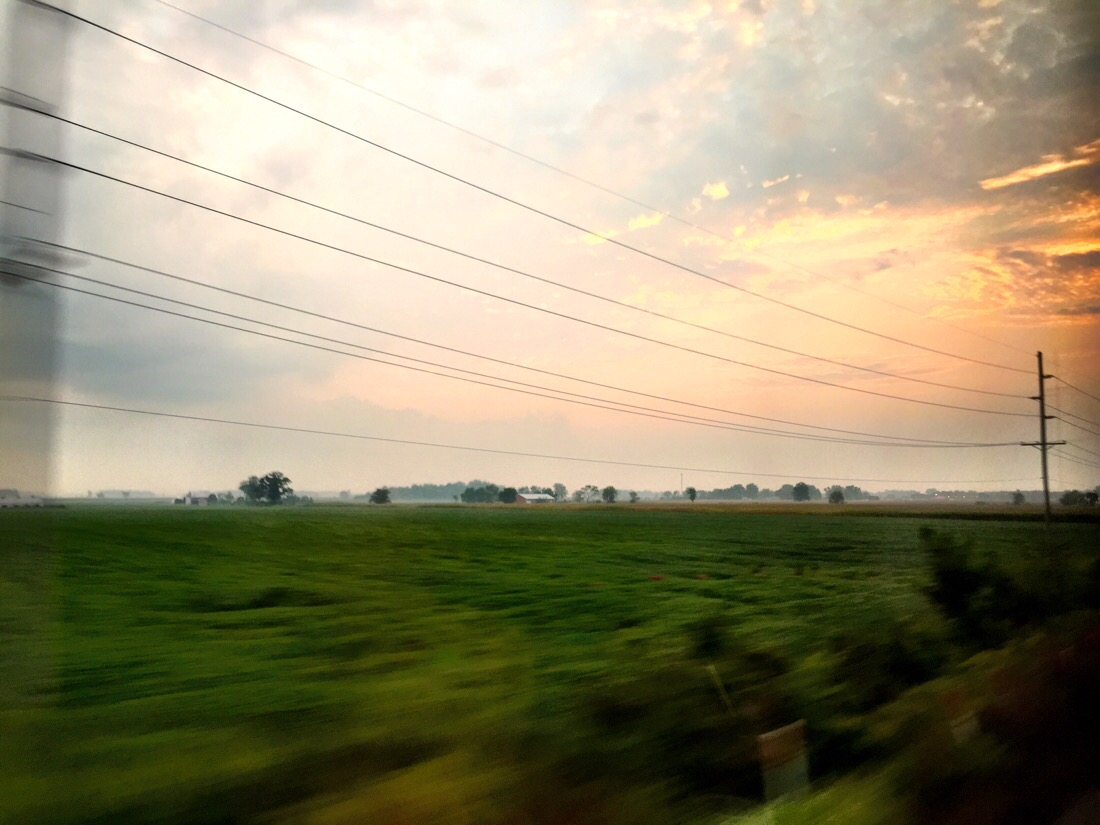 sunrise in indiana from the window of the amtrak train - capitol limited