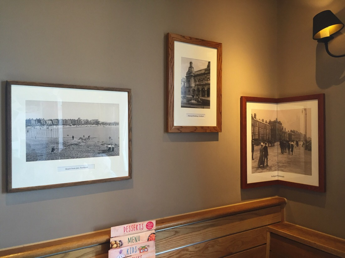 photographic art on the walls of the guelder rose pub in southport, uk