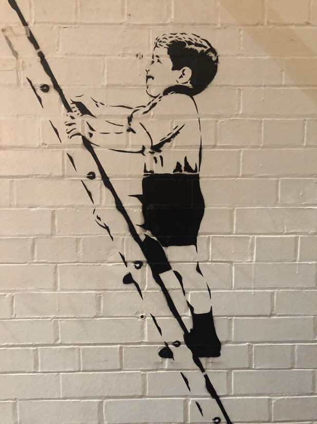 Wall art at red brick hanger market in Liverpool