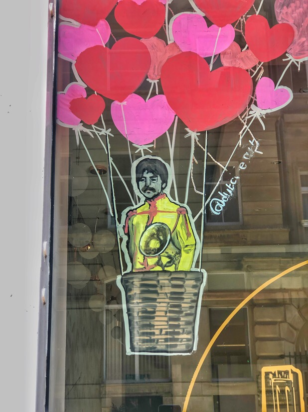 Valentines window display at Lucy In The Sky coffee shop in Liverpool, England featuring the The Beatles in balloons
