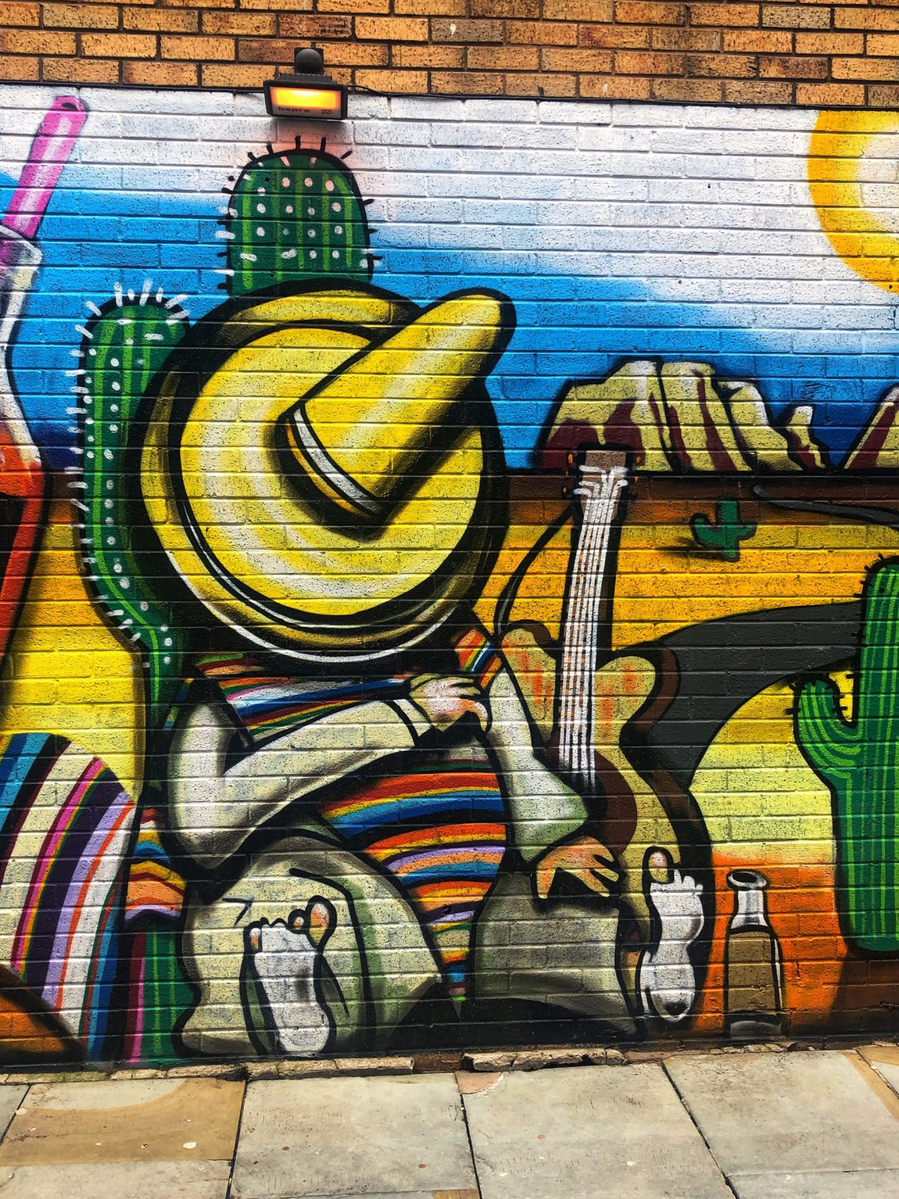 Street art on the walls of La Parrilla Mexican restaurant on Bold Street in Liverpool, England