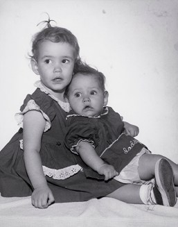 Me and my sister before we were given up for adoption