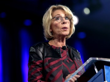 Betsy Devos School reopening shooter education DC Satire