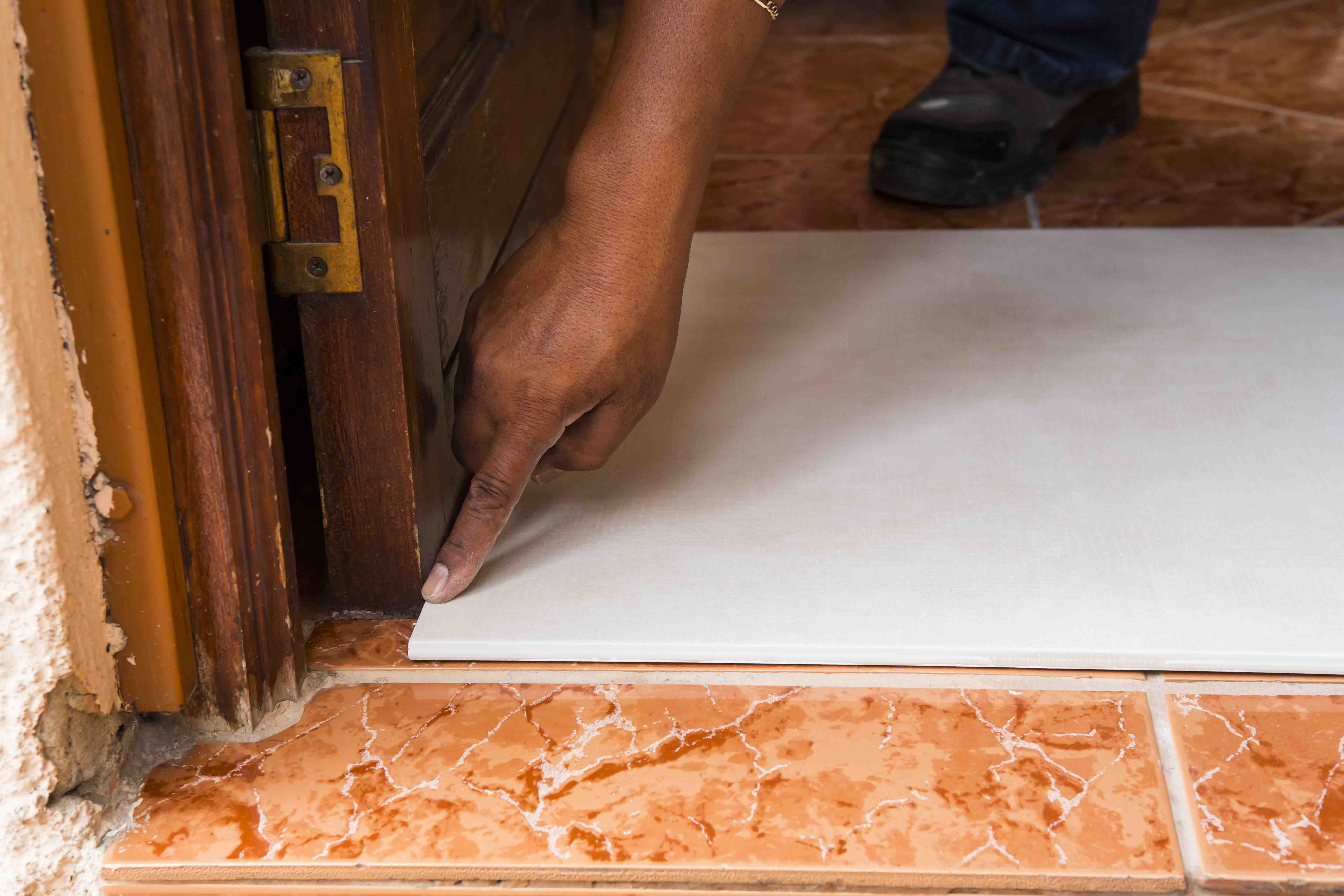 how to tile over existing tiles successfully