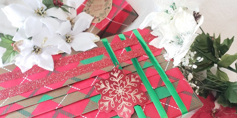 Gift Wrapping tips for terrible wrappers. A pleated and ribbon wrapped gift