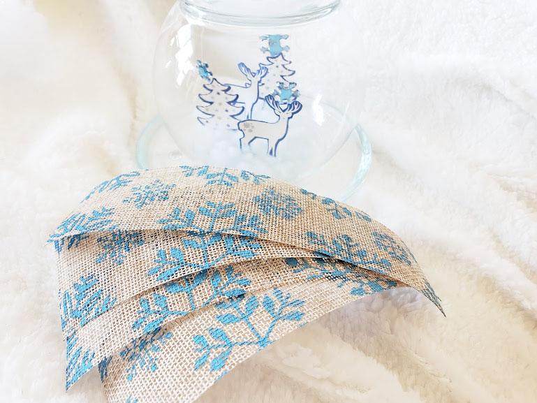 DIY Dollar Tree Christmas Globe, using burlap ribbon to decorate the top