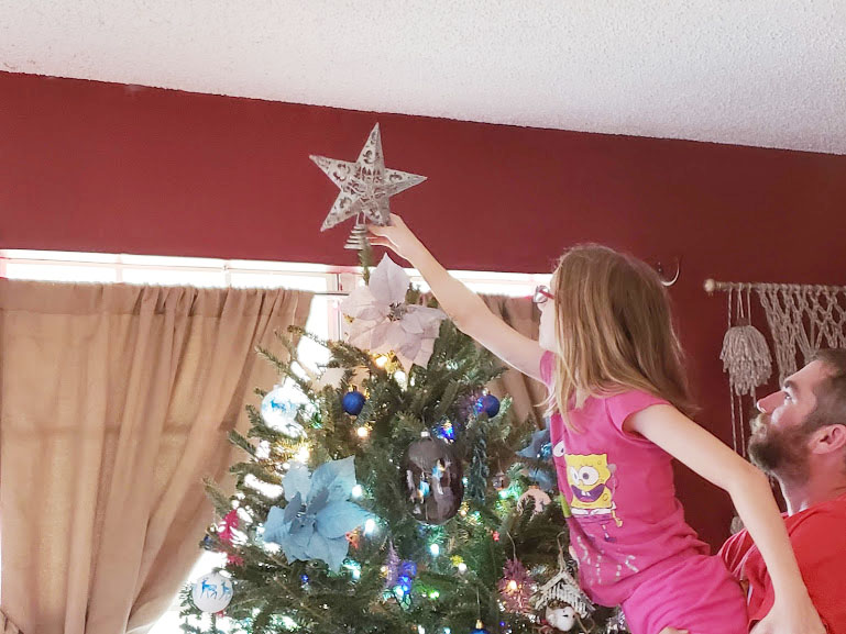 kids helping to decorate the Christmas tree based on our Family Christmas Traditions