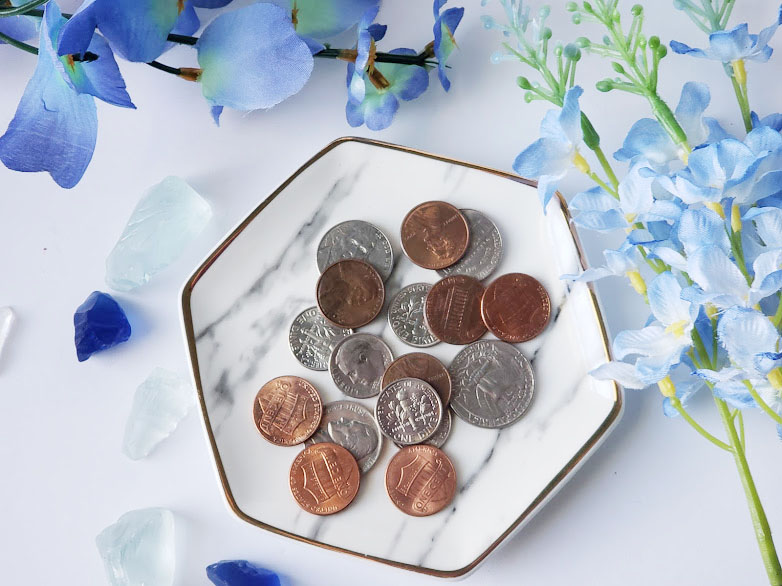 Side hustles for stay at home moms, a decorative dish with change in it