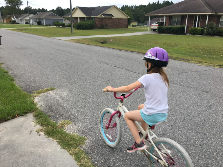 Spending time together outside, like learning to ride a bike, can help your child excel at school