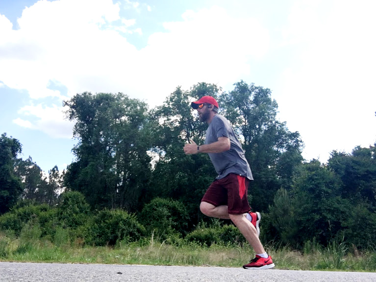 Man sprinting wwhile doing speed workouts