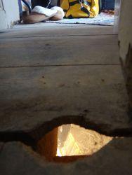 Peeking through the floorboard hole