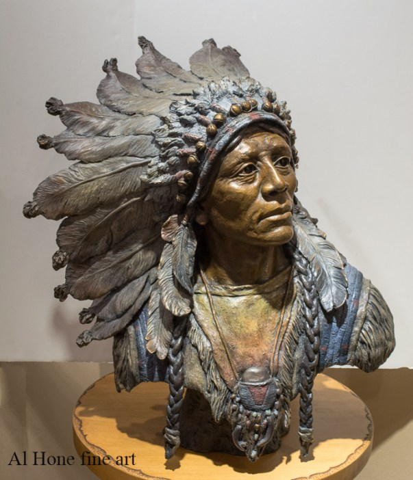 Native American sculpture. I walk the red road