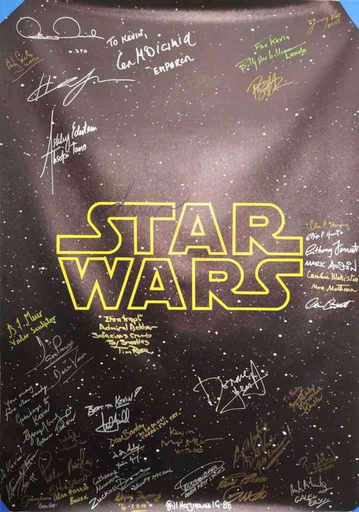 Star Wars Poster signed by multiple cast members. Autographs from Mark Hamill and more.