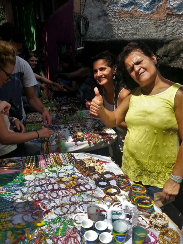 Ladies selling handmade jewellry on our Rio Favela Tour