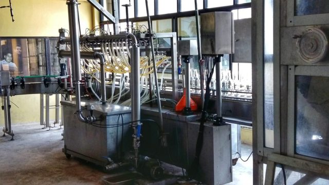 The Bottling machine at Cuello's Rum Distillery in Orange Walk Belize