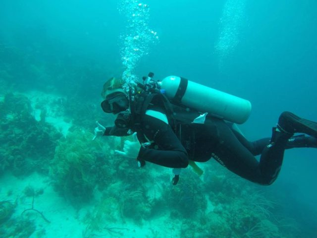 Me diving in Utila, signalling that everything is cool