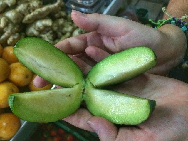 Tasting fruits in the market in Bogota Awesome budget things to do in Bogota Colombia - what to do in Bogota for Backpackers