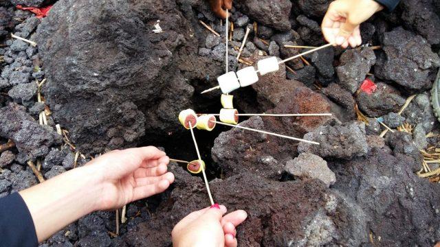 Toasting Marshmallows on the hot lava on Pacaya Volcano near Antigua Guatemala