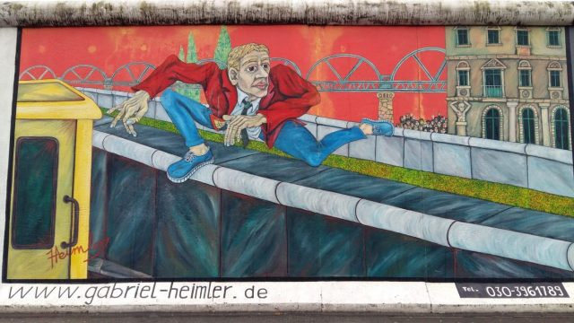 Visiting the Berlin Wall - The East Side Gallery shows artist's impressions of the Wall & how many people tried to flee East Germany