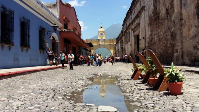 What to do in Antigua Guatemala - The Arch in Antigua with a reflection in the puddle