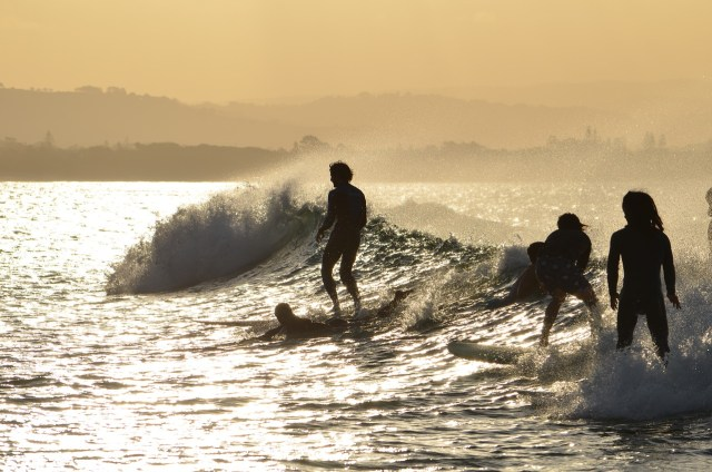 Surfing at Byron Bay Beach - Byron Bay Backpacking Guide